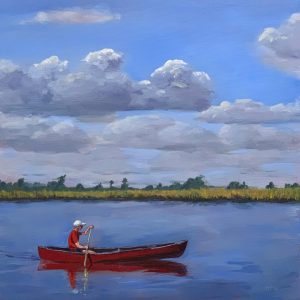 Man in a red canoe on the river